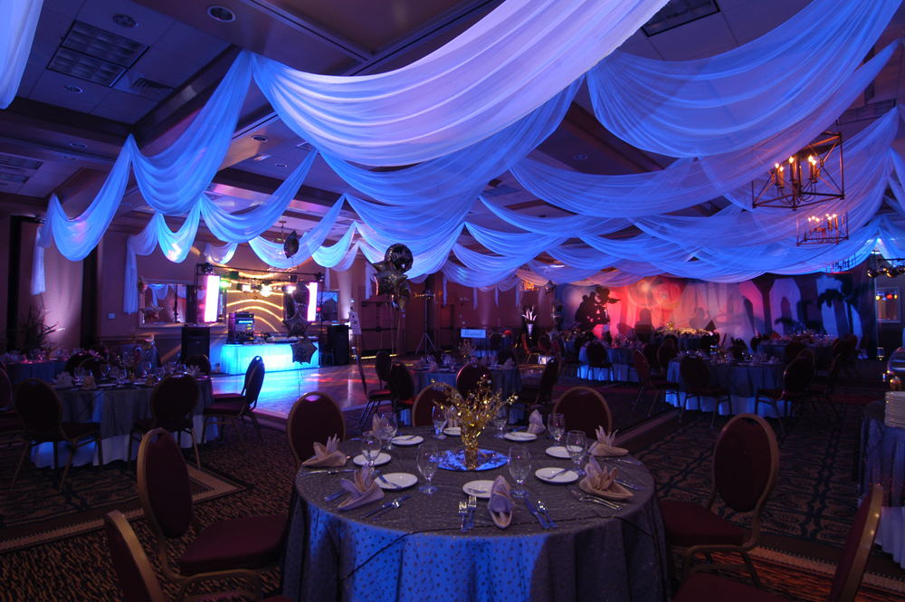 White chiffon ceiling treatments made to size by W Drapings for a birthday celebration. Photo by Concept Photography.