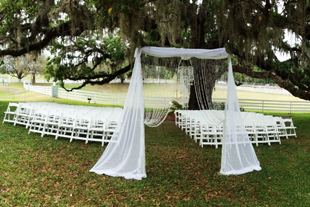 Custom chiffon detail with decorative strings of crystal beads for an outdoor ceremony at Highland Manor in Apopka, FL. Photo and drapes by W Drapings.