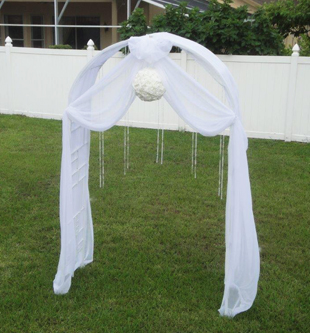 Outdoor ceremony arch draped in white chiffon and decorative strings of crystal beads. Photo and drapes by W Drapings.