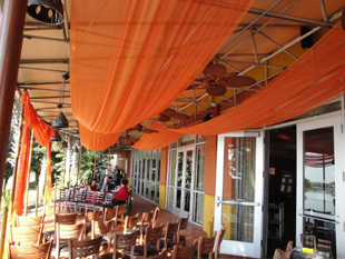 Custom ceiling treatments in festive orange chiffon for a wedding reception at Samba Room in Orlando, FL. Photo and drapes by W Drapings.